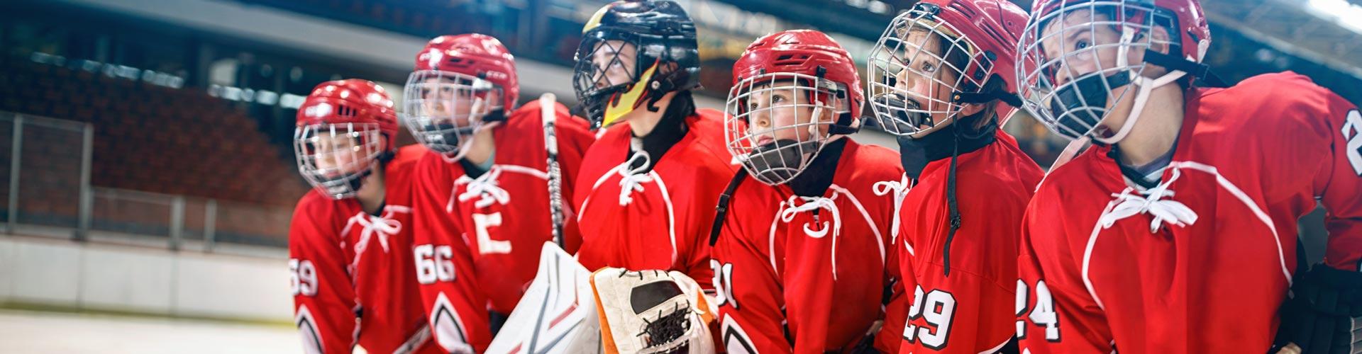Young hockey team - children play ice hockey
